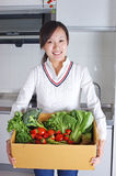 Young wife and vegetables Royalty Free Stock Image