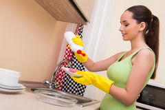 The young wife woman washing dishes in kitchen Royalty Free Stock Photography