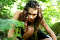 A young and wild brunette woman in a forest Royalty Free Stock Photo