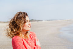 Young wind hair girl on the seaside Royalty Free Stock Image