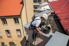 Young Window Cleaner Descend from the Roof of the Building Stock Image