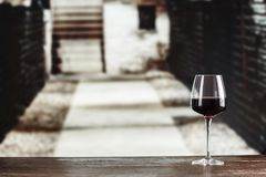Wine in the wine cellar. Young wine in glasses against the background of the cellar. in the cellar wine is located on the shelves along the walls royalty free stock photos