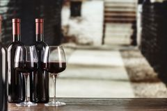 Young wine in glasses. Against the background of the cellar. in the cellar wine is located on the shelves along the walls royalty free stock photography