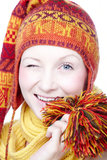 Young winking. Young woman in colorful hat winking Royalty Free Stock Photography