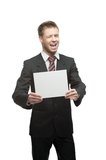 Young winking businessman holding sign Royalty Free Stock Photos