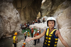 Young winner. Group of young sportsmen in Goynuk canyon, Kemer, Turkey stock image