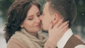 Young winter couple against blurred christmas snowfall on Winter Day. stock video