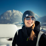 Young winter girl with cap and sunglasses Stock Photos