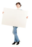 Young winter woman with blank placard Royalty Free Stock Photo