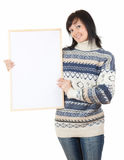 Young winter woman with blank sign. Beautiful young winter woman with blank sign, white background Stock Photography
