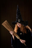 Young witch. On dark background Royalty Free Stock Photography