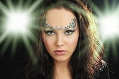 Young witch with amazing make-up royalty free stock photo