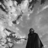 Young witch in a black robe stock photos