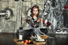 The young witch conjures Royalty Free Stock Photo