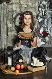 The young witch conjures Royalty Free Stock Image