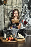 The young witch conjures Royalty Free Stock Images