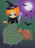 A young witch flying on a broomstick Royalty Free Stock Images