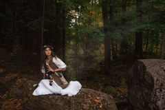 A young witch in forest royalty free stock images