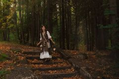 A young witch in forest stock image