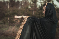 Young witch in a forest Royalty Free Stock Image