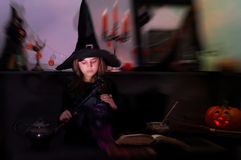 Young witch on Haloween Royalty Free Stock Photos