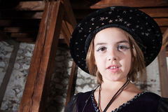 Young Witch in Hat Stock Photography