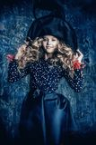 Young witch in hat stock photo