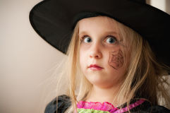 Young witch with hat stock photo