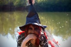 Young witch in pointed black hat Stock Photo