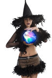 The young witch posing with magic ball Stock Photo