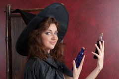 Young witch with potions Royalty Free Stock Image