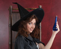 Young witch with potions Royalty Free Stock Photos