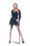 Young witch with scythe Royalty Free Stock Photography