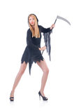 Young witch with scythe Royalty Free Stock Image