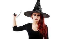 Young witch with scythe Stock Photo