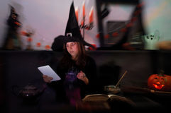 Young witch with tablet Royalty Free Stock Photography