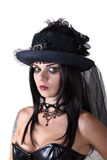 Young witch in veil hat royalty free stock image