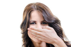 Young Woiman Covering Mouth. Young  Brunette Woman Laughing, Covering Mouth with Her Hand - over White Stock Image