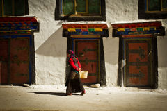 A young woma walks in a remote southern Tibetan Village Stock Photo
