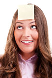 Young woma with yellow sticky note. On forehead Stock Photo