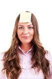 Young woma with yellow sticky note. On forehead Royalty Free Stock Photography