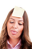 Young woma with yellow sticky note. On forehead funny mime Stock Photos