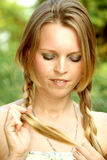 Young woman braids (untwist) pigtails Royalty Free Stock Photography