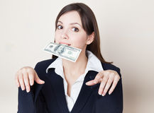Young woman with 100 dollars in her mouth Royalty Free Stock Photos