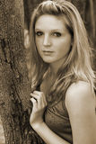 Young woman. Leaning on a tree Royalty Free Stock Images