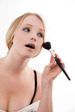 Young woman. Applies makeup with a soft brush beautiful skin stock images