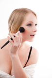 Young woman. Applies makeup with a soft brush beautiful skin royalty free stock photos