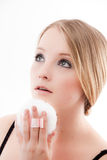Young woman. Applies make-up with a powder puff beautiful skin stock images