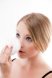 Young woman. Applies makeup with a powder puff beautiful skin royalty free stock photos