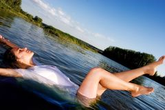 Young woman. Relaxing in water stock photography